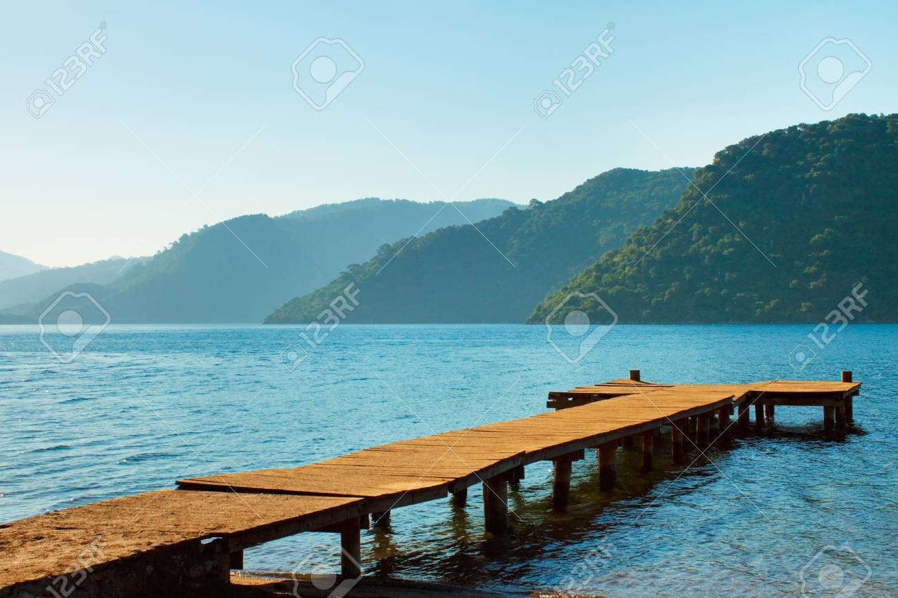 mountains and old wooden pier to the sea  Marmaris  Turkey Stock Photo - 14505131