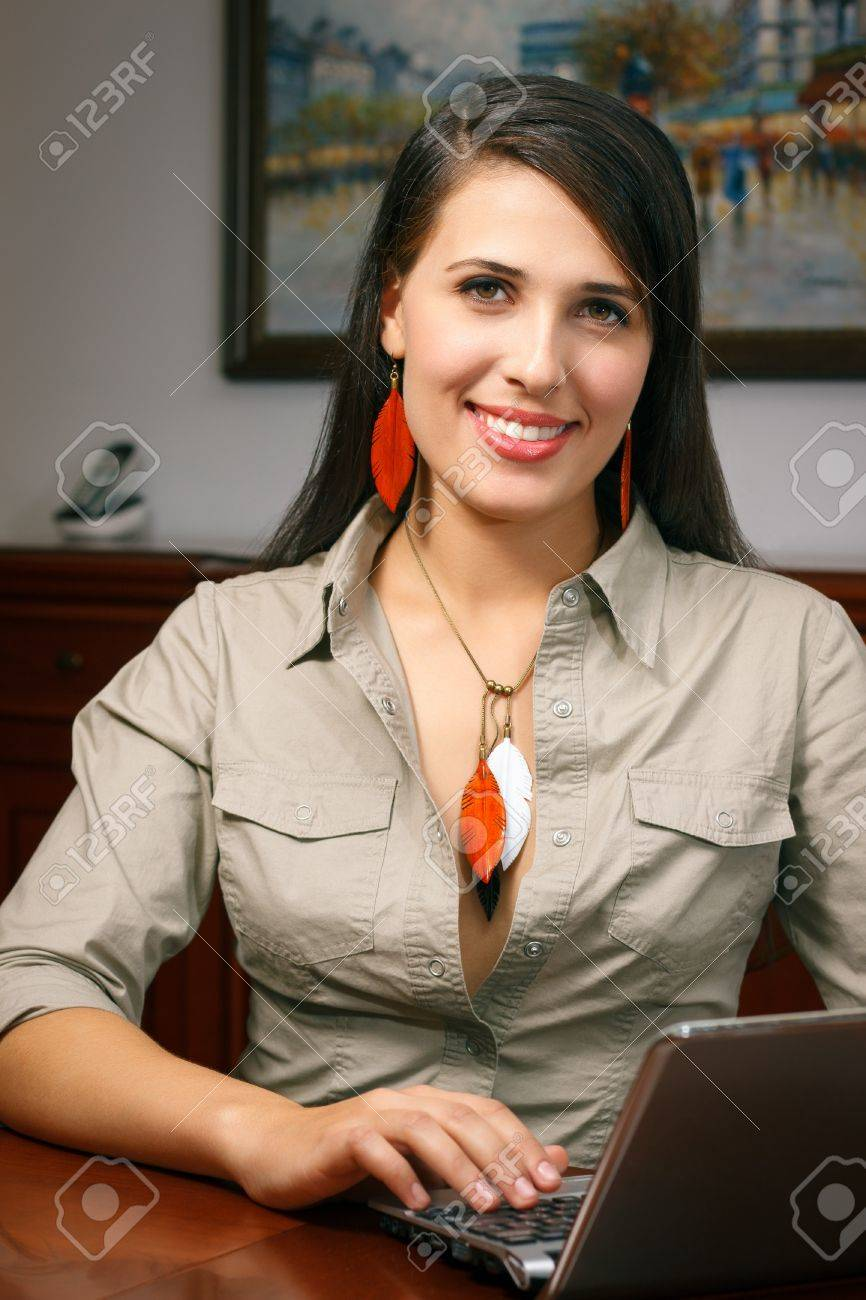 elegant young woman with jewelry works at office Stock Photo - 15968309