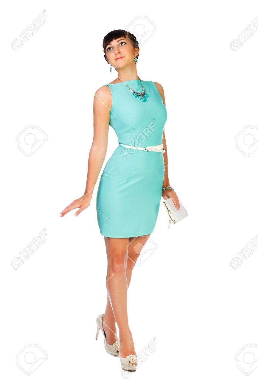 beautiful woman brunette in turquoise dress with handbag on white background Stock Photo - 21307485