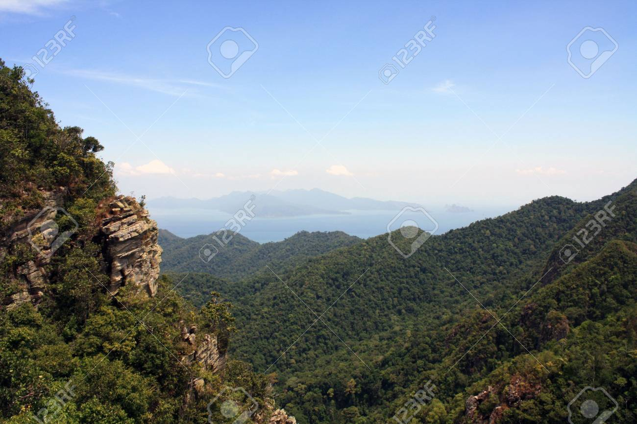 View of peaks of mountain and the sea and island in the horizon from a high altitude Stock Photo - 7297332