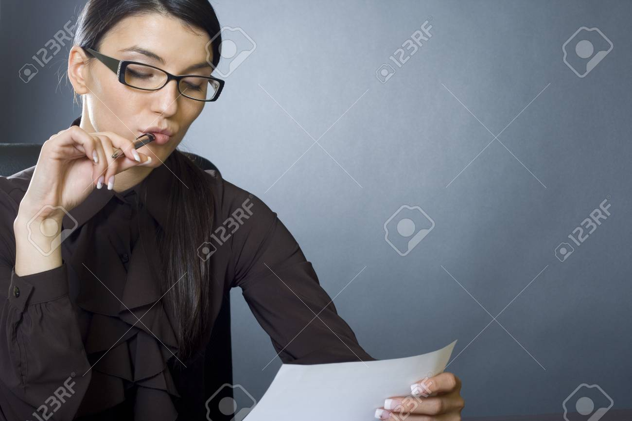 attractive businesswoman reading Stock Photo - 4191456