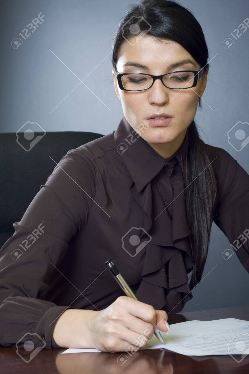 attractive businesswoman writing Stock Photo - 4191508