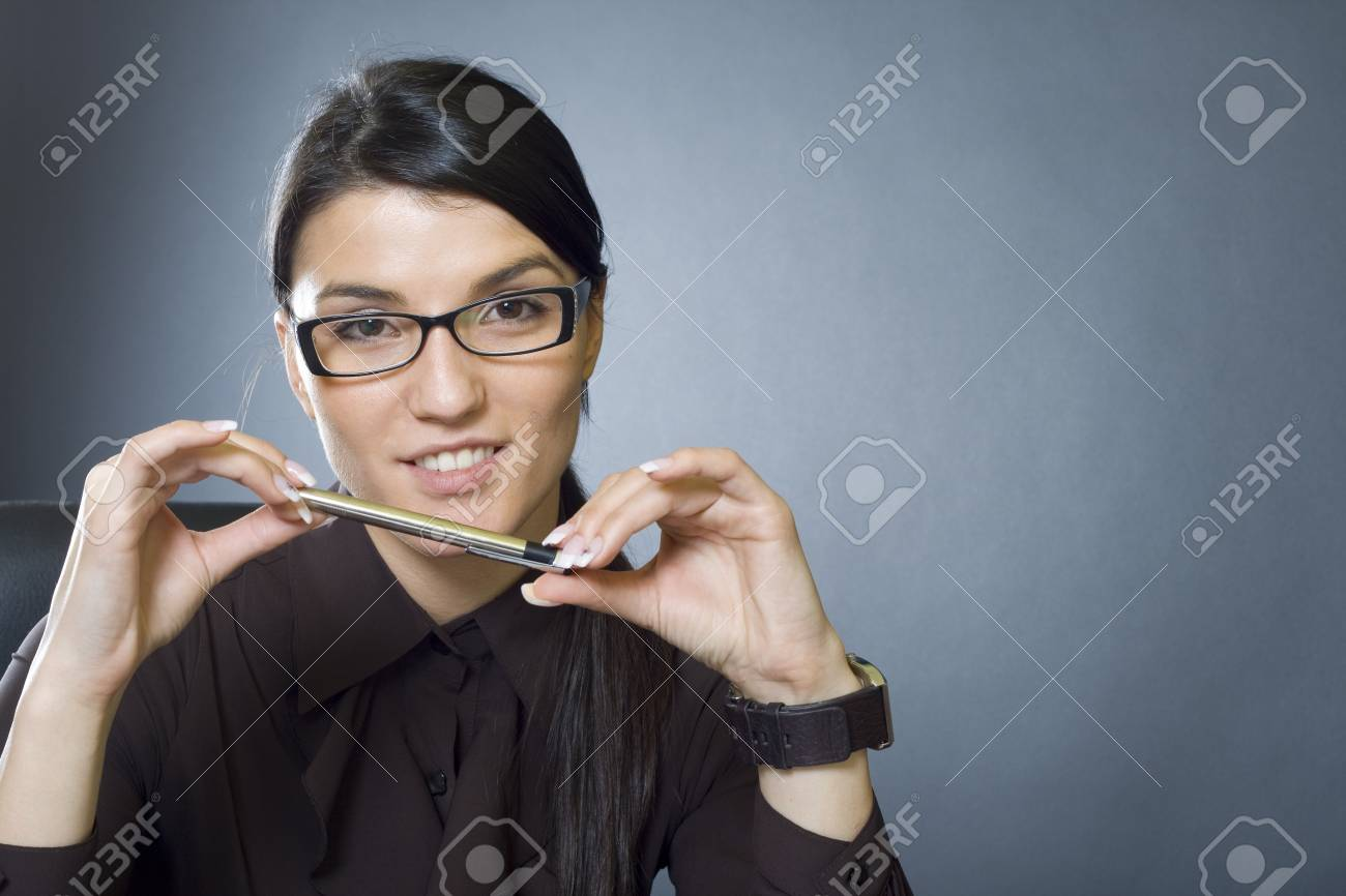 attractive businesswoman playing with pen Stock Photo - 4191464