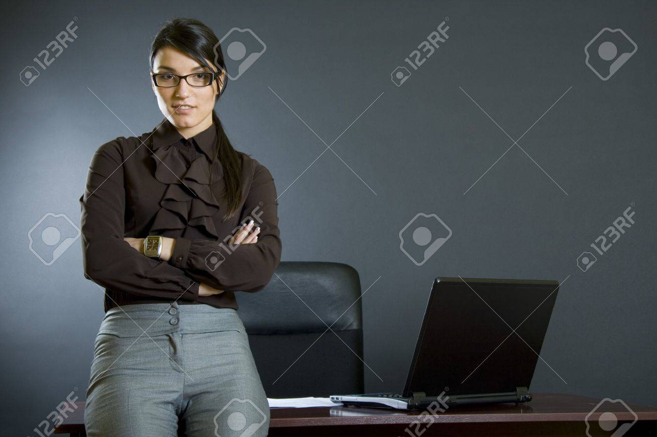 attractive business woman against desk Stock Photo - 4191485