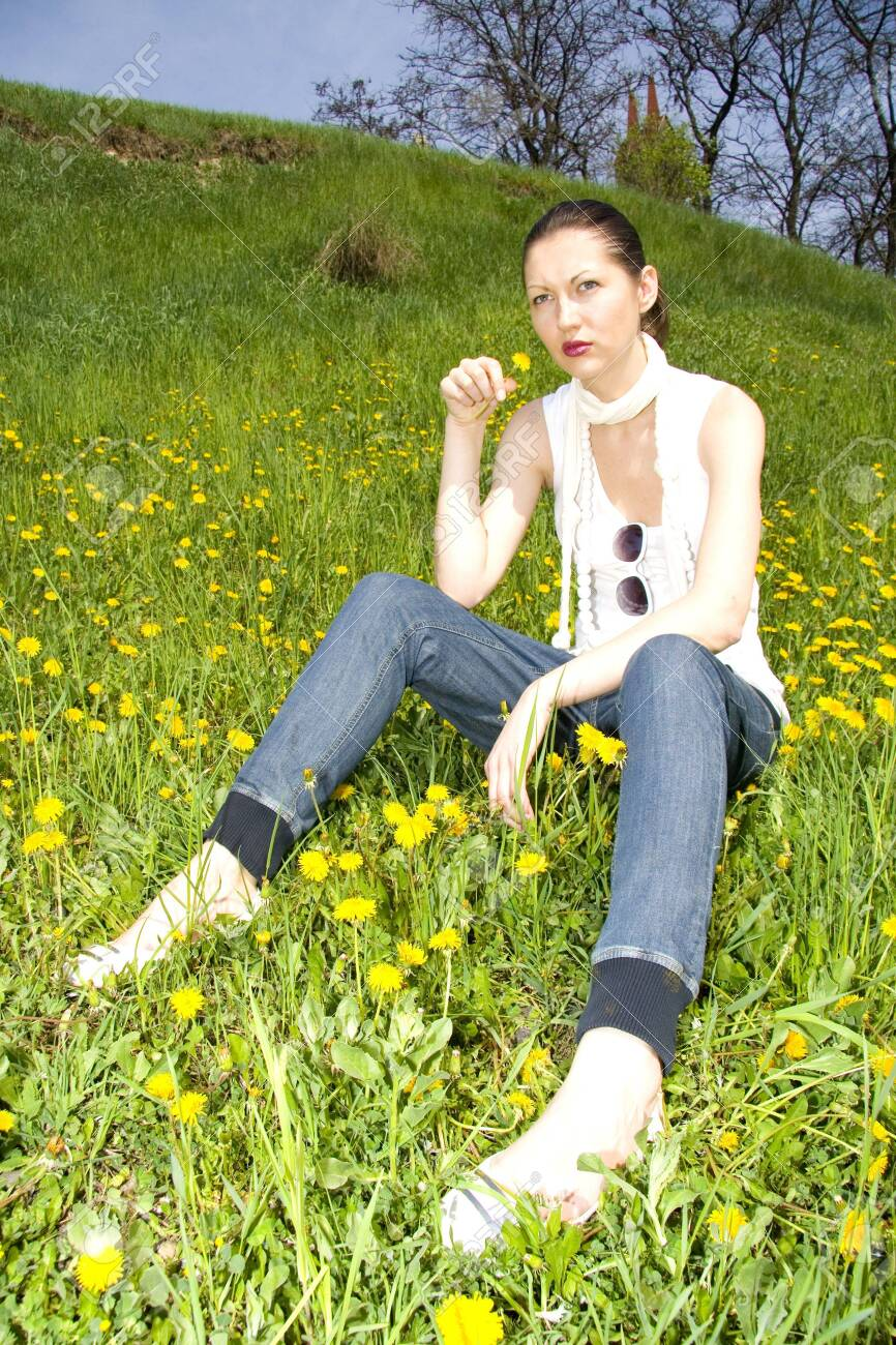young woman in nature smelling flowers Stock Photo - 4675574
