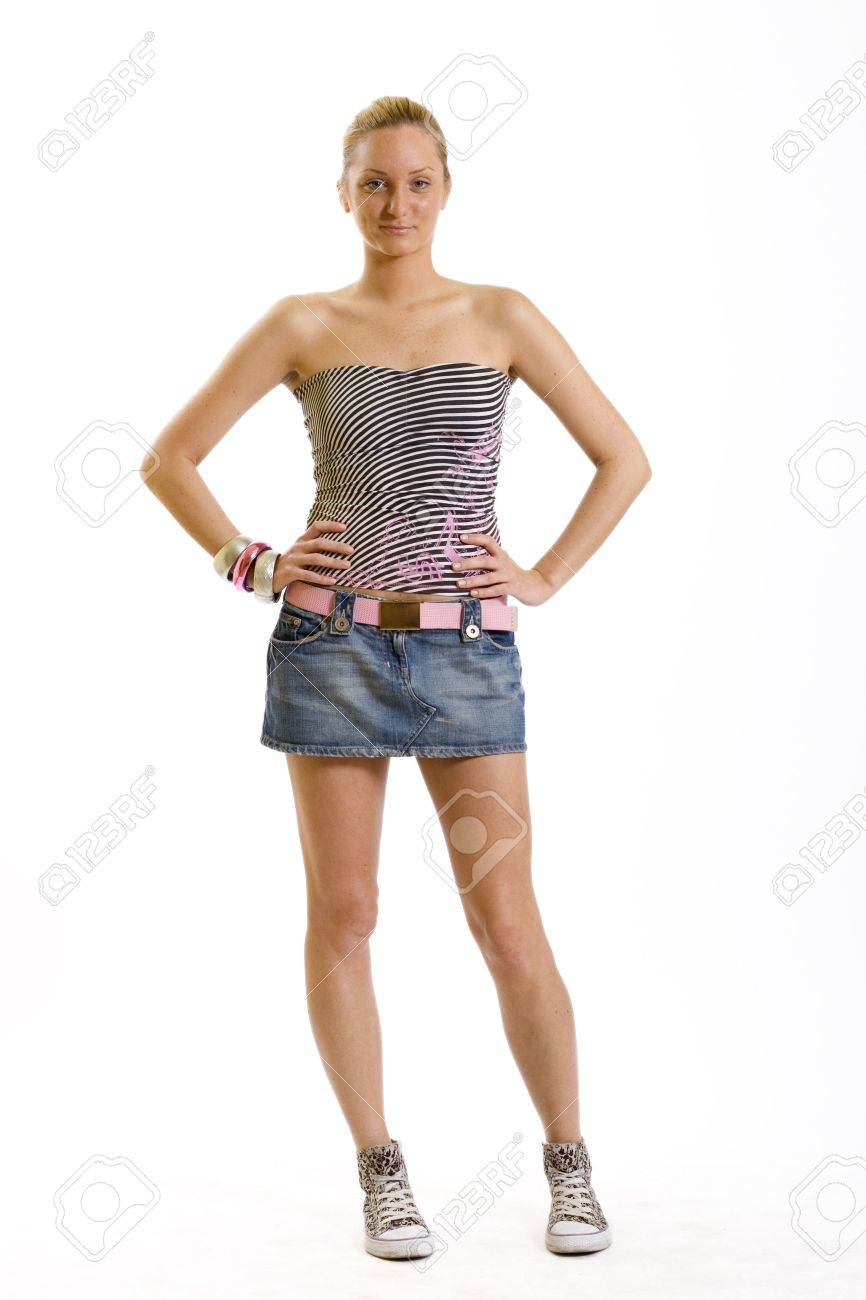 beautiful young woman standing with hands in on hips Stock Photo - 5293651