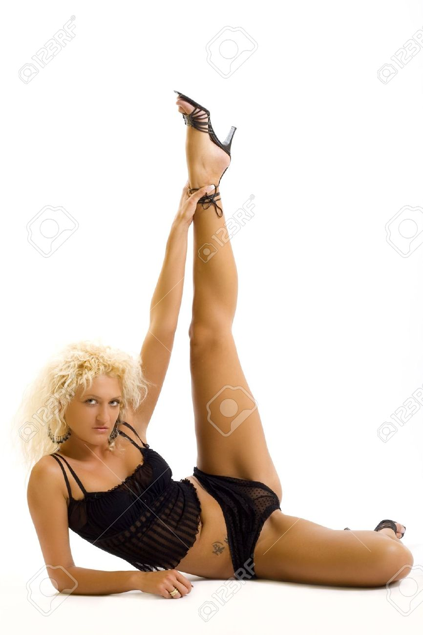 blond woman with spread legs over white background stock photo