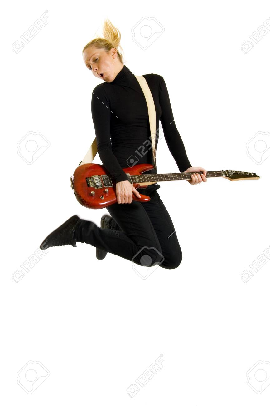 picture of a headbanging woman guitarist jumps Stock Photo - 5592347