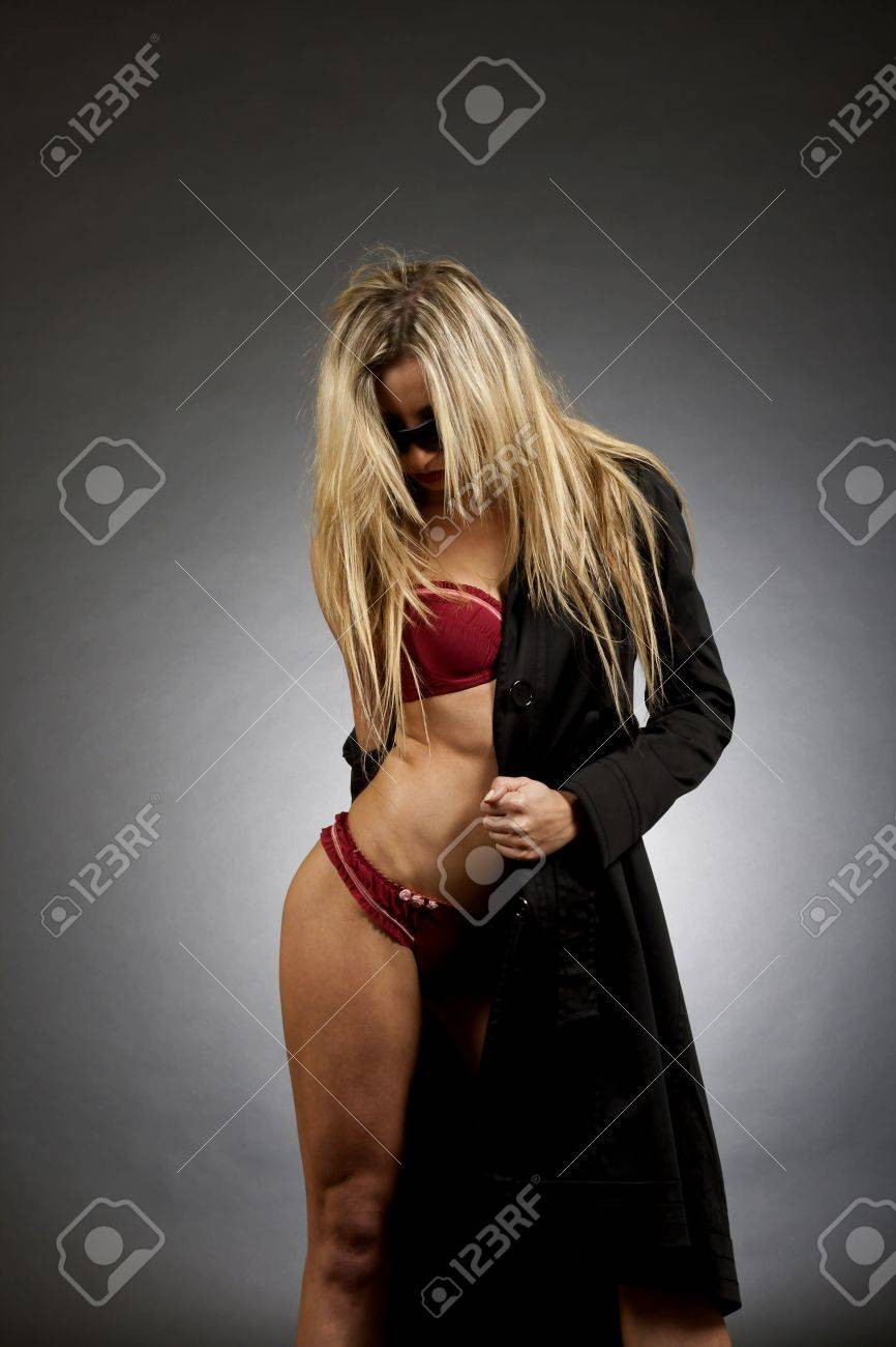 sexy woman removing her clothes on dark background Stock Photo - 6661832
