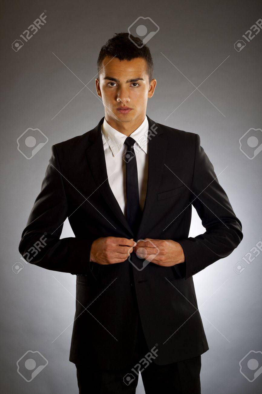 businessman buttons up the button on the suit Stock Photo - 6877552