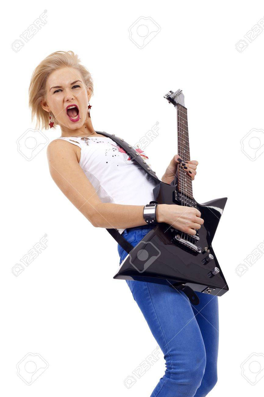 beautiful young and attractive woman playing a guitar with passion Stock Photo - 6969948