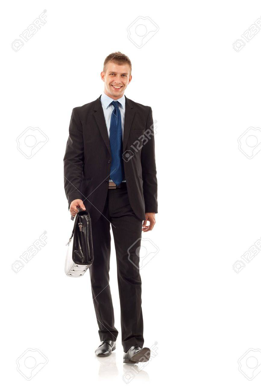 Portrait of a happy young business man carrying a suitcase, walking on white background Stock Photo - 8043112