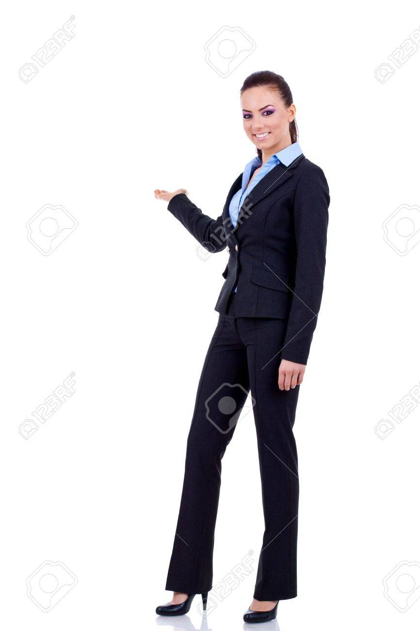 Business woman points at something in her back. Isolated on white background Stock Photo - 8936906