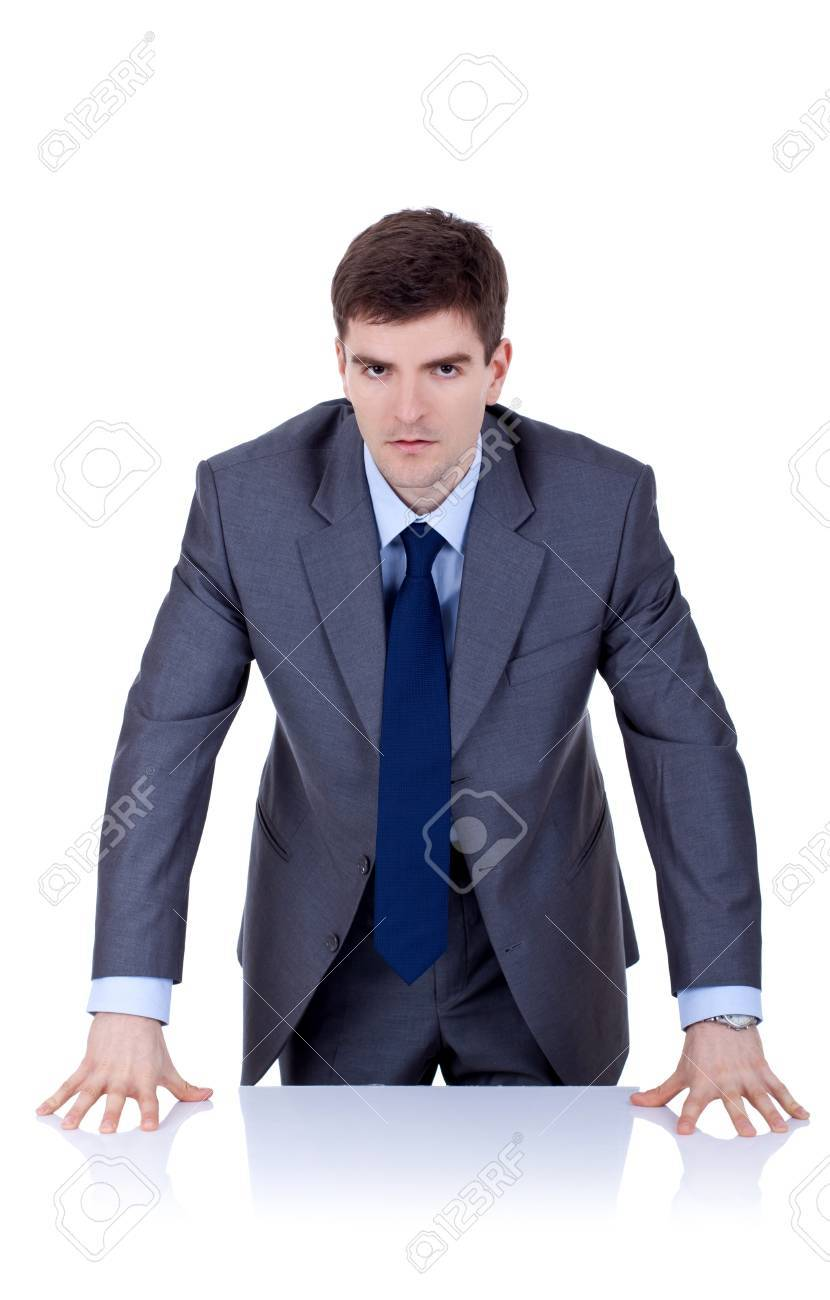 Angry business man behind the desk , over white Stock Photo - 9076564