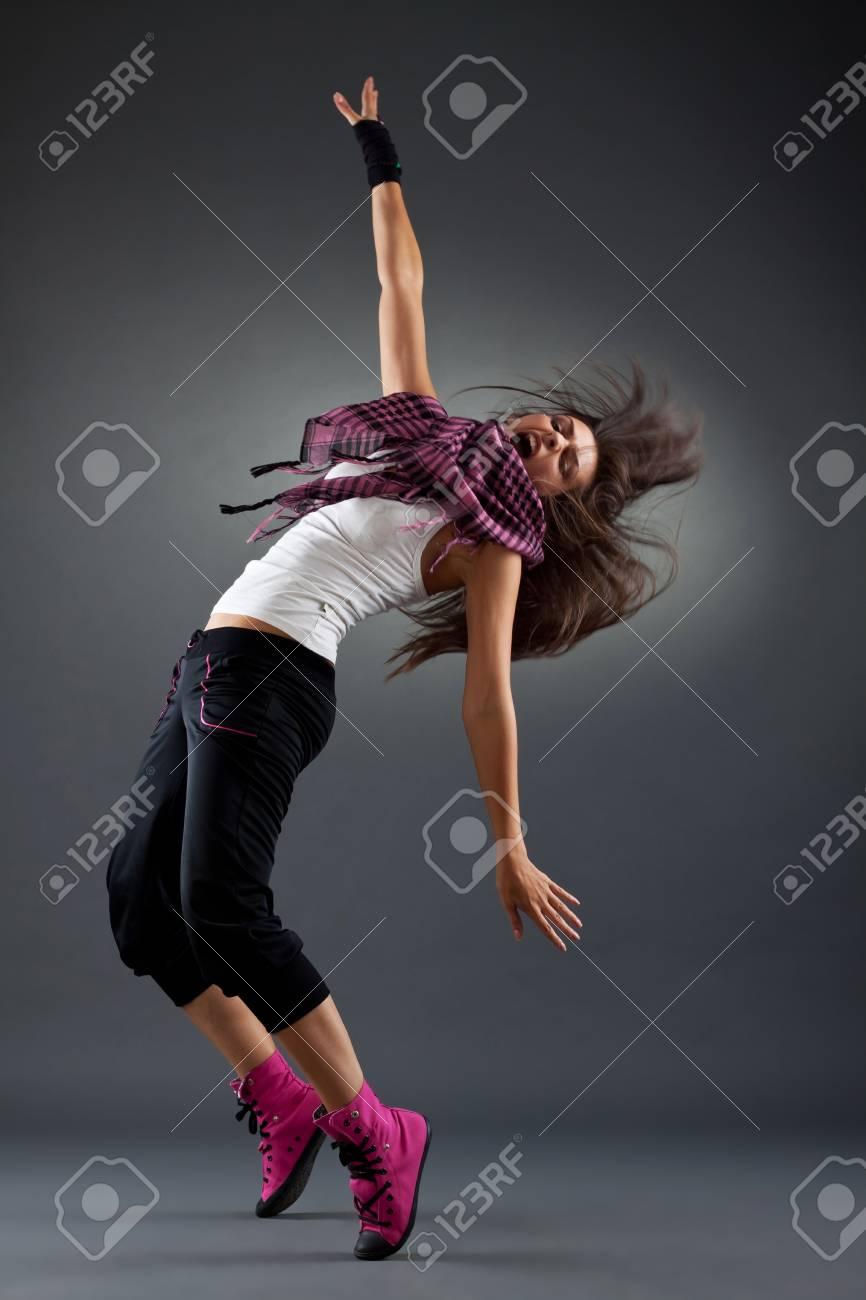 headbanging modern style dancer posing on black background Stock Photo - 9370460