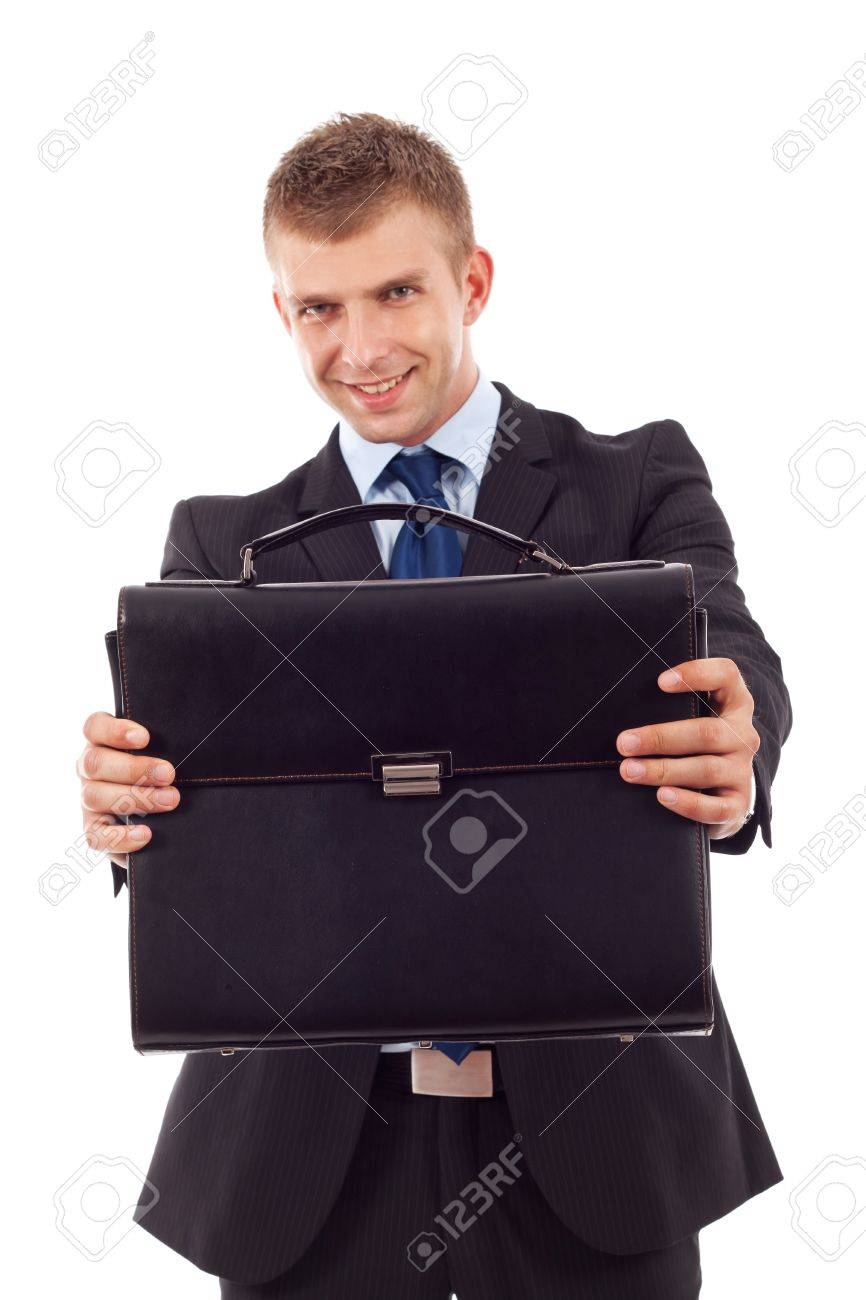 young business man offering a black briefcase over white Stock Photo - 10520937