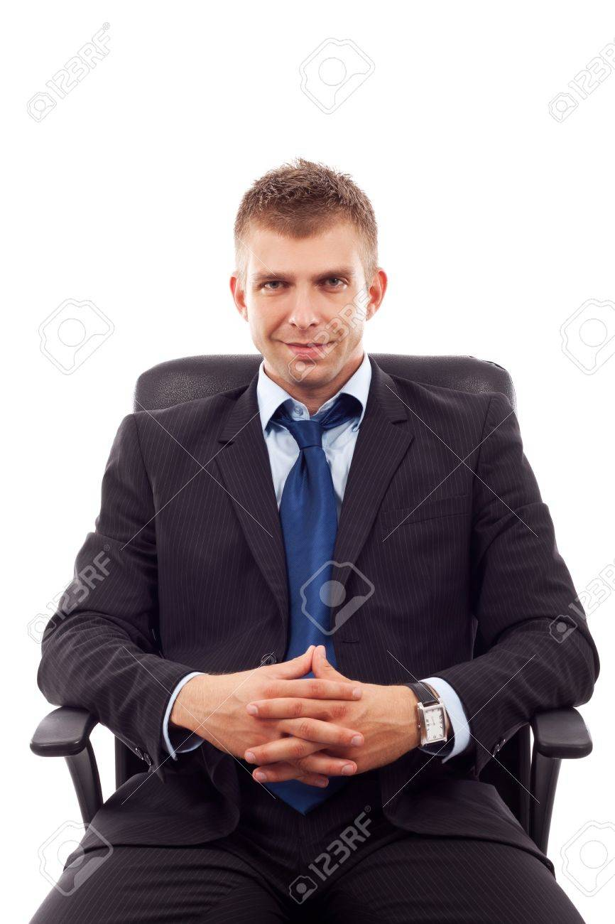 handsome business man sitting in office chair over white Stock Photo - 10520975
