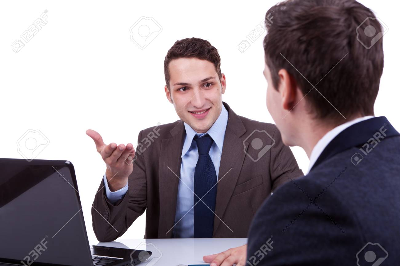 two young business men having a discussion at their desk Stock Photo - 11188318
