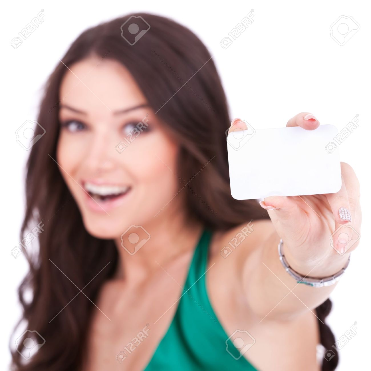 Close-up portrait of female holding credit card, shallow depth of field, focus on the credit card, over white background Stock Photo - 11317525