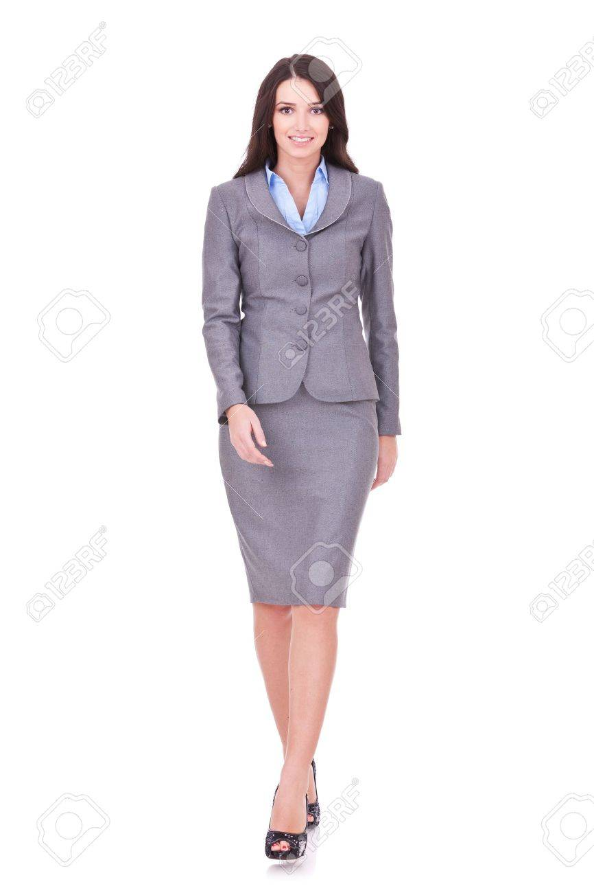 Business woman walking in full length on white background Stock Photo - 11317501