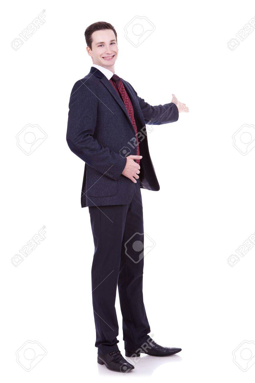 4e66b31b54 Full length of business man in black suit making presentation to copy space  isolated on white