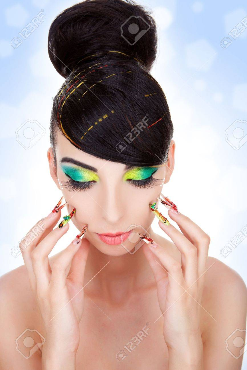Fashion style, manicure, cosmetics and make-up.  Shiny slicked back hairstyle. Beautiful woman pushing her nails against her face Stock Photo - 11971771