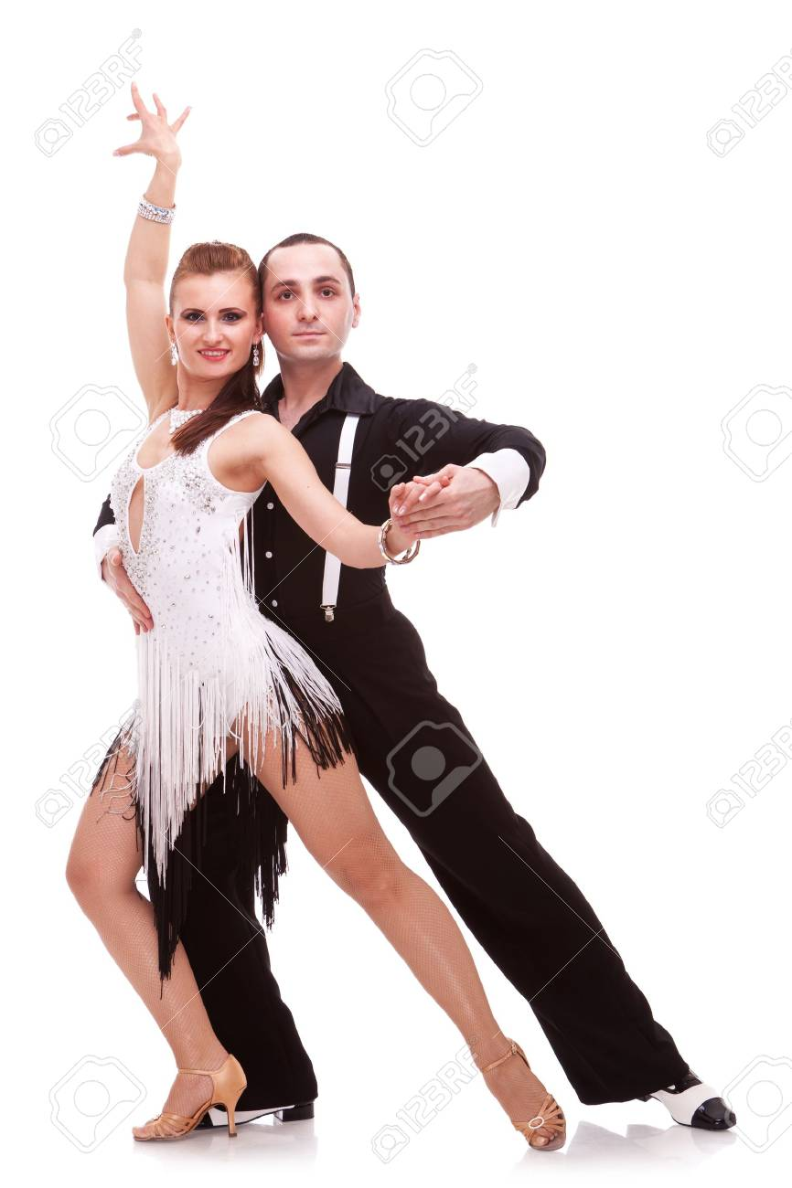 sensual salsa dancing couple on white background. couple of latino dancers making a dance move and posing for the camera Stock Photo - 12581720