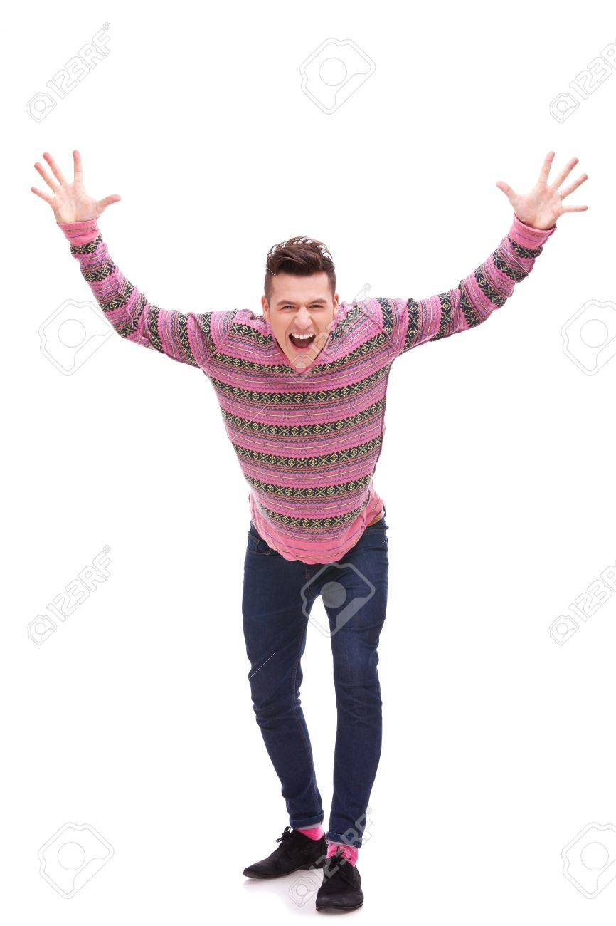Casual man looking very happy with his arms up, isolated on white background . Excited young guy with hands in the air Stock Photo - 12581745