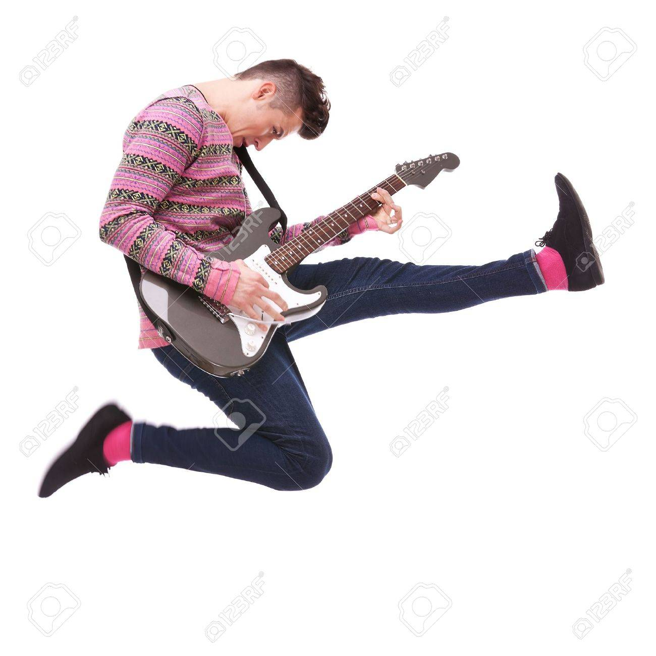 passionate guitarist jumps in the air on white background. casual man playing an electric guitar and jumping Stock Photo - 12581623