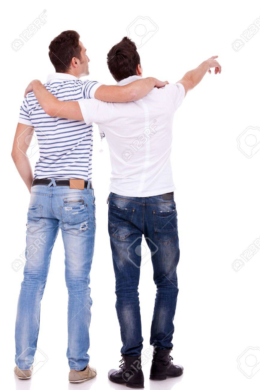 Back view of  two young men pointing at something. Rear view. Isolated over white background. Stock Photo - 12582543
