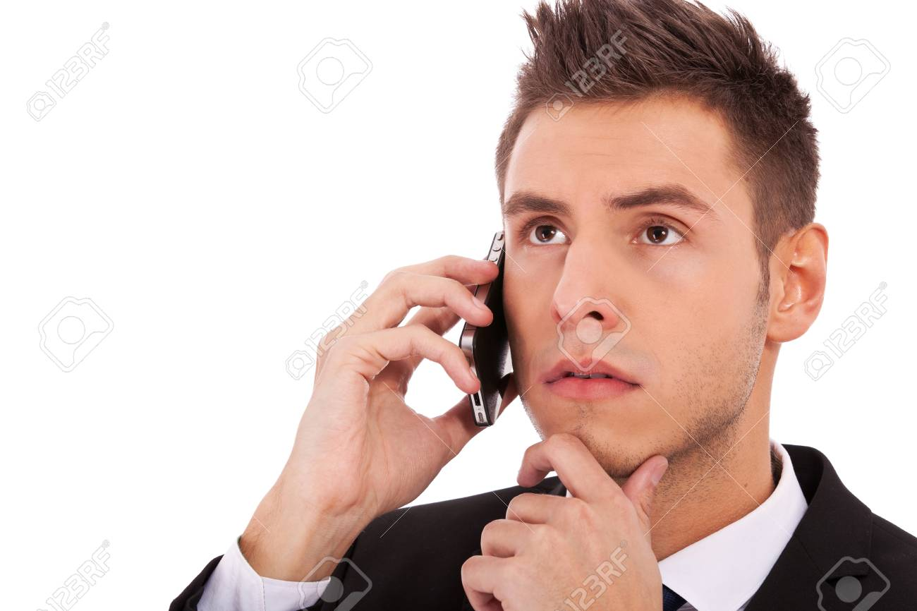Close up of business man on the phone looking to the side against a white background Stock Photo - 13311883