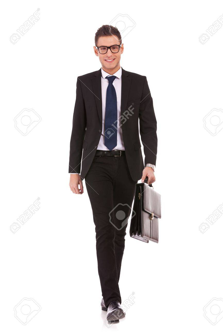 Portrait of a happy young business man carrying a suitcase, walking on white background Stock Photo - 13310556