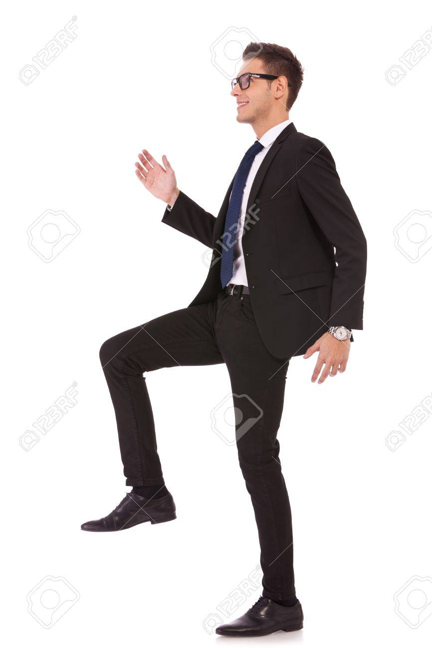 business man stepping up against a white background Stock Photo - 13310599