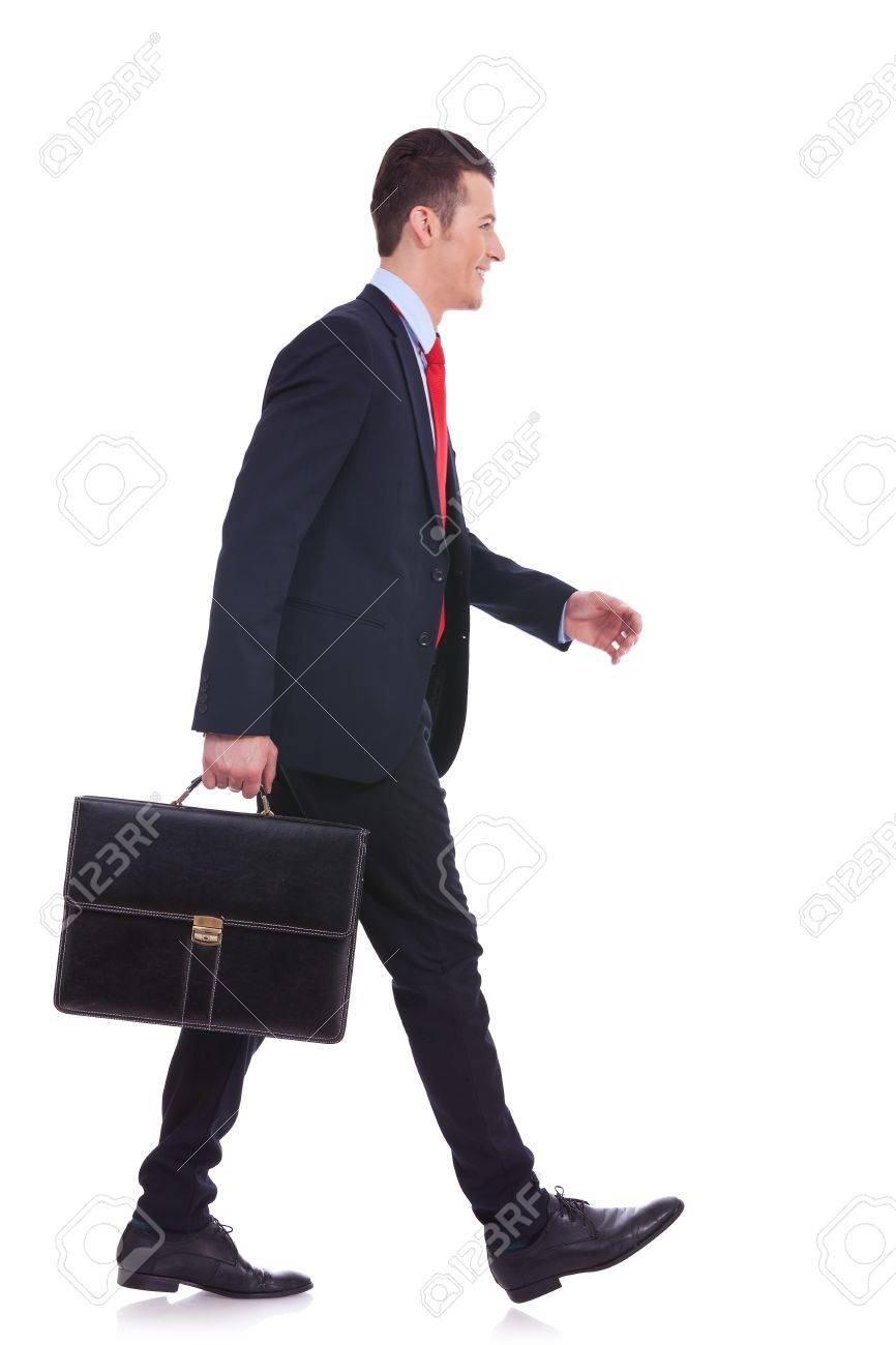 side view business man holding brief case and walking over white background Stock Photo - 14637662