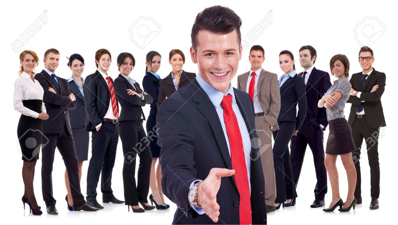 Isolated successful business team, focus on man with handshake gesture. young business man welcoming to the team Stock Photo - 15154737