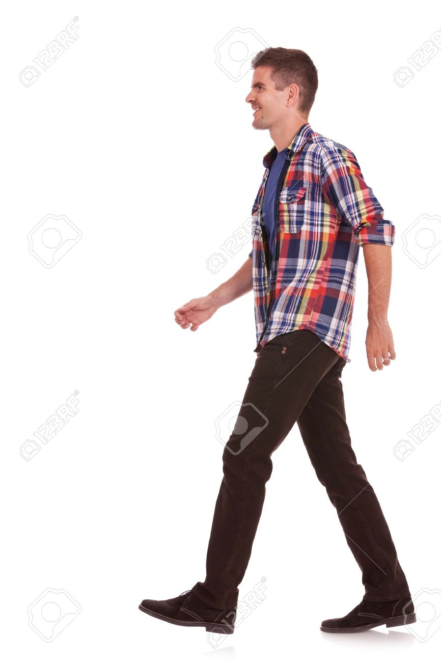 1fbe1492afb2 side view of a young casual man walking on a white background Stock Photo -  15333384