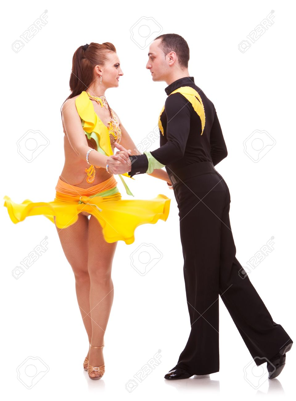 sweet salsa couple looking at eachother while dancing Stock Photo - 15691777