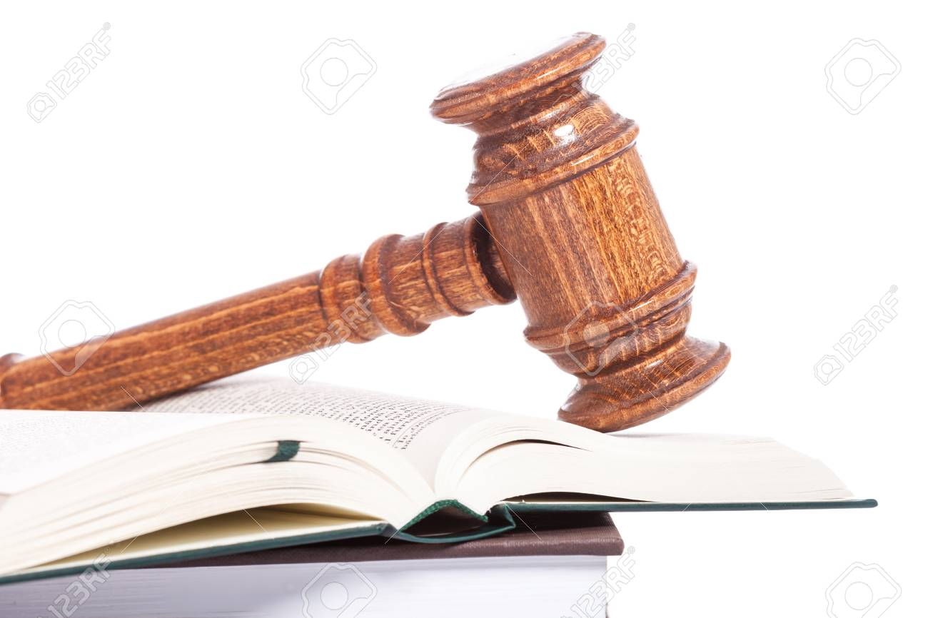 wooden judge gavel on an open book, on white background Stock Photo - 15736747