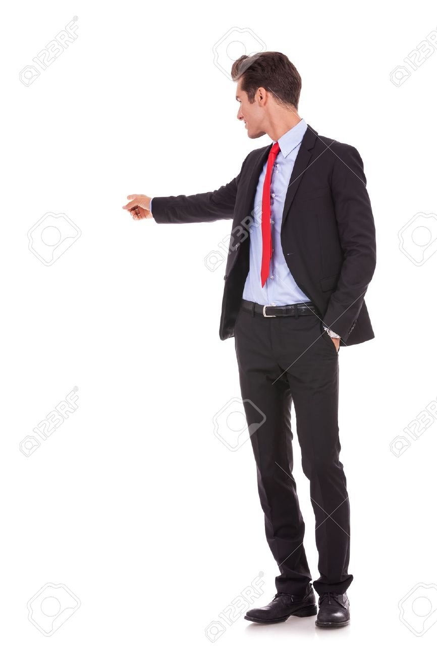 young business man pointing at something at his back on white background Stock Photo - 15737999