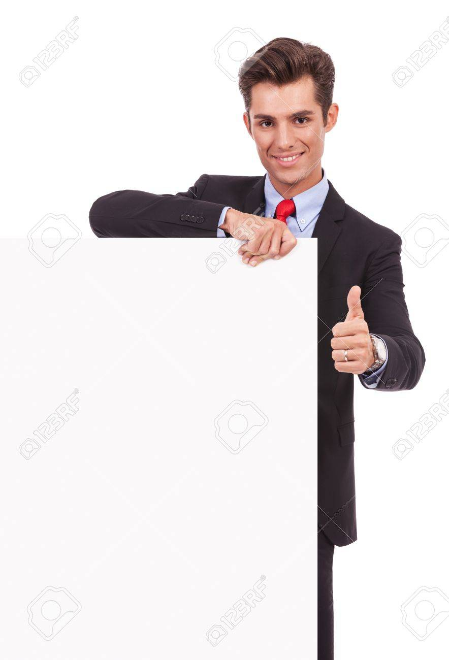 Young business man with blank board making ok thumbs up gesture on white background Stock Photo - 15738207
