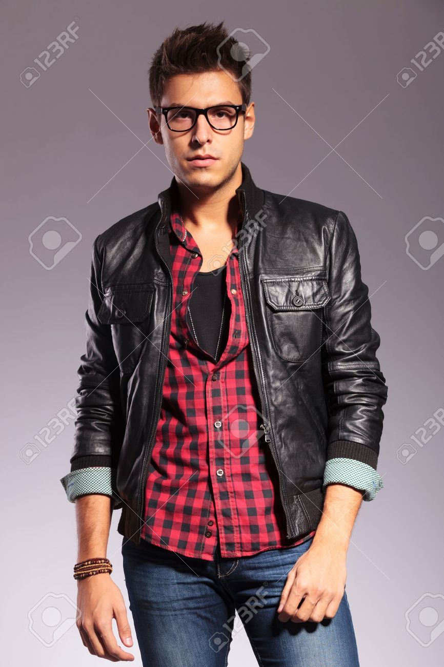 Handsome Young Man In A T-shirt Jeans And A Leather Jacket Stock