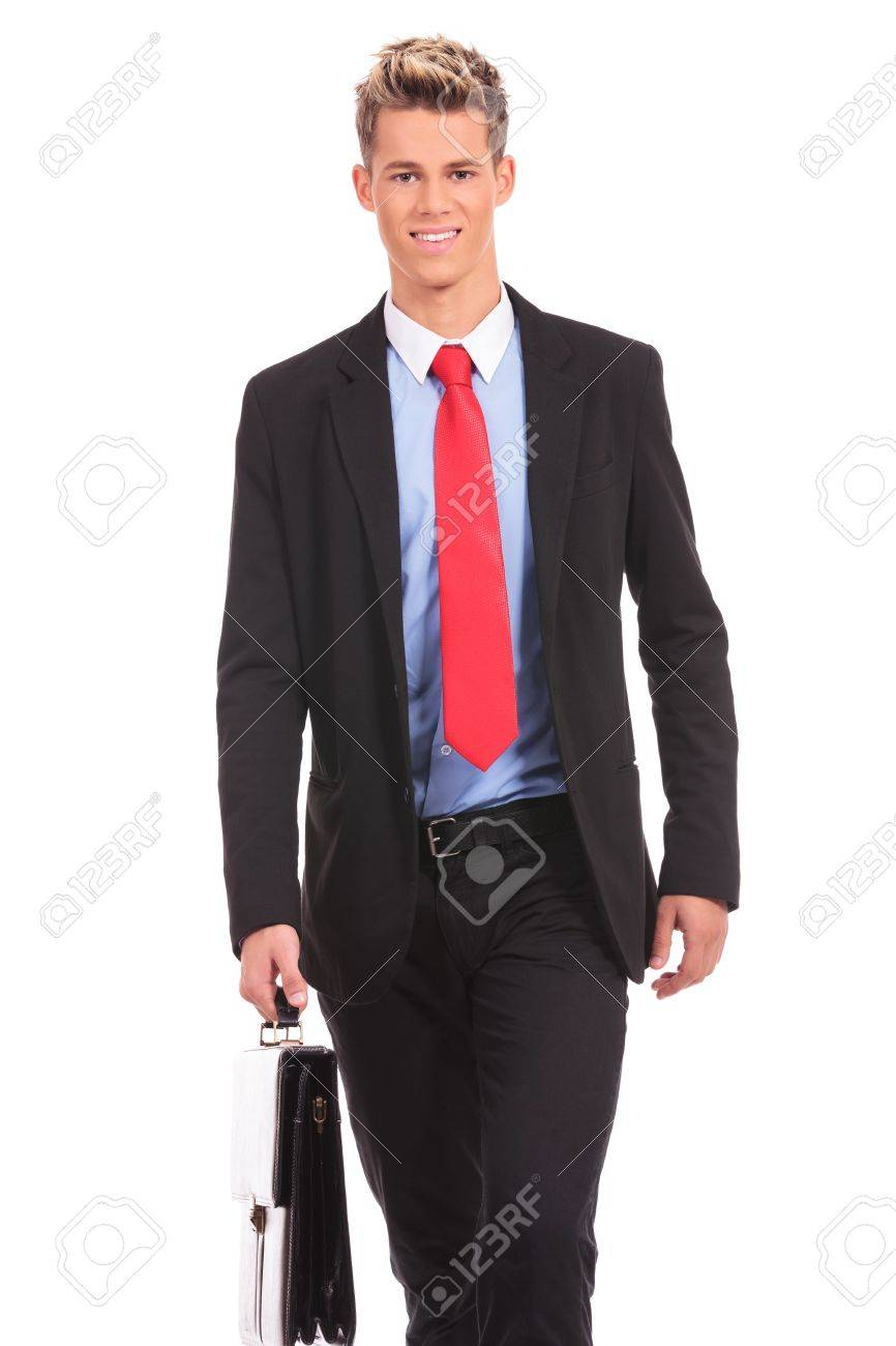 smiling business man wearing glasses is walking with a briefcase Stock Photo - 17242337