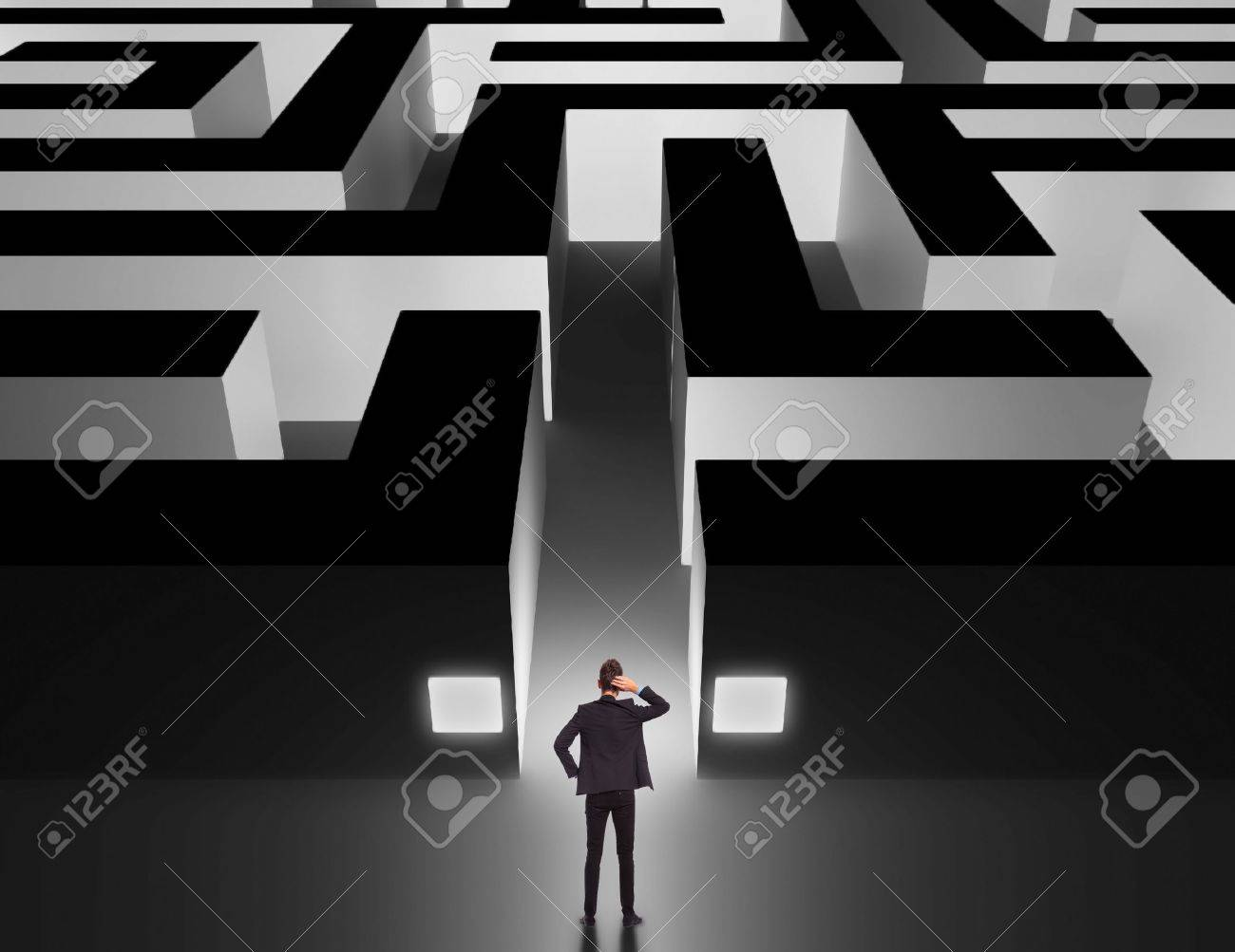 Business man in front of a huge maze thinking how to get through Stock Photo - 17230386