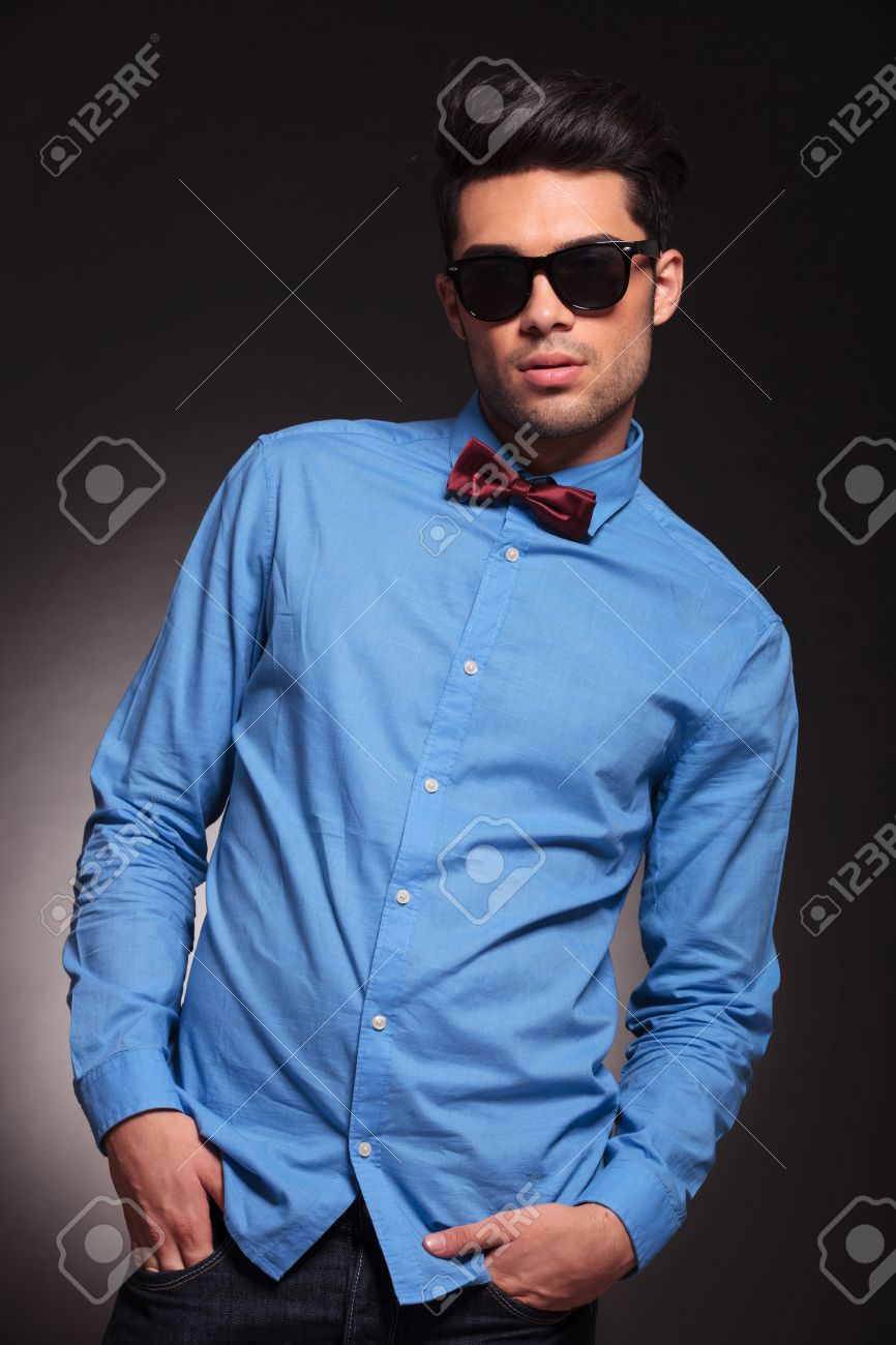 Attractive Fashion Man Dressed Casually In A Blue Shirt And Bow