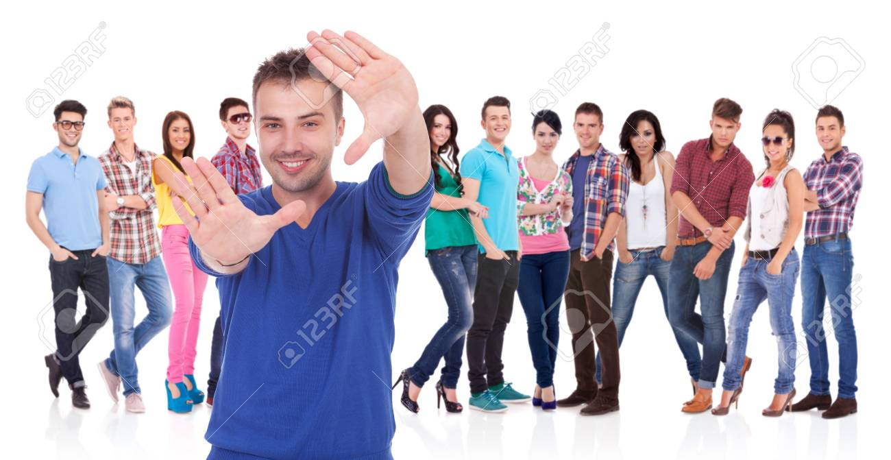 young casual man making a hand frame in front of his team Stock Photo - 17449629