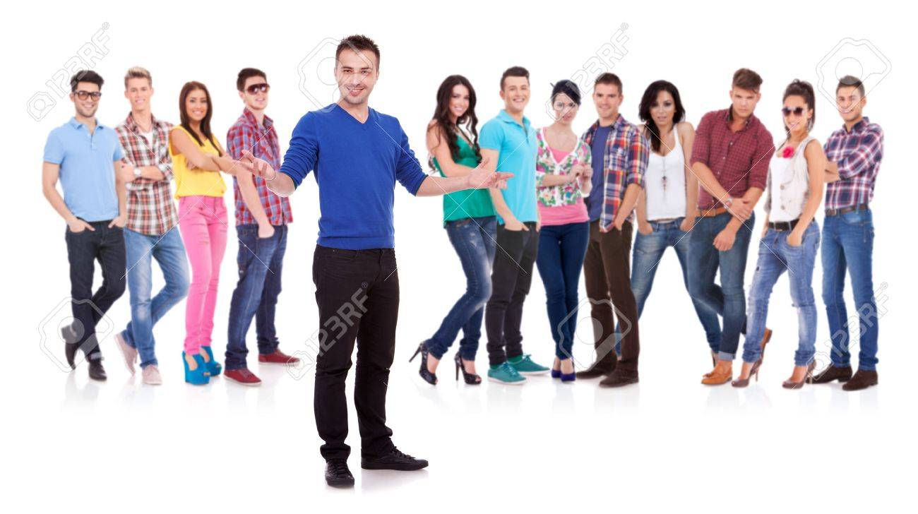 young casual man welcoming to his casual fashion team Stock Photo - 17449699