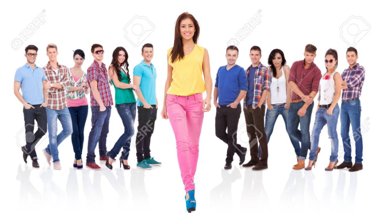 young fashion casual woman walking forward in front of a large team Stock Photo - 17449697