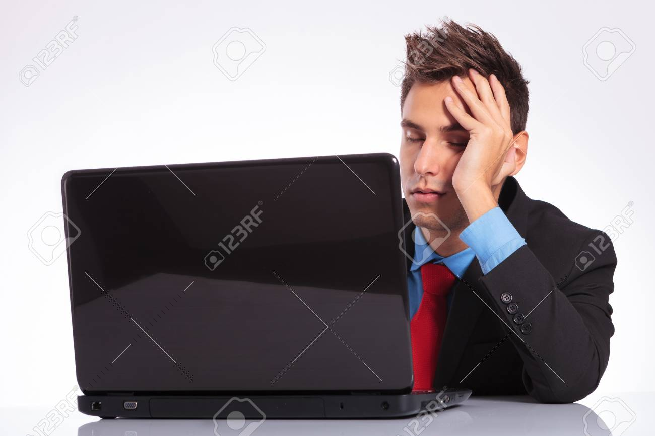 young business man sleeping in front of his laptop Stock Photo - 18025375