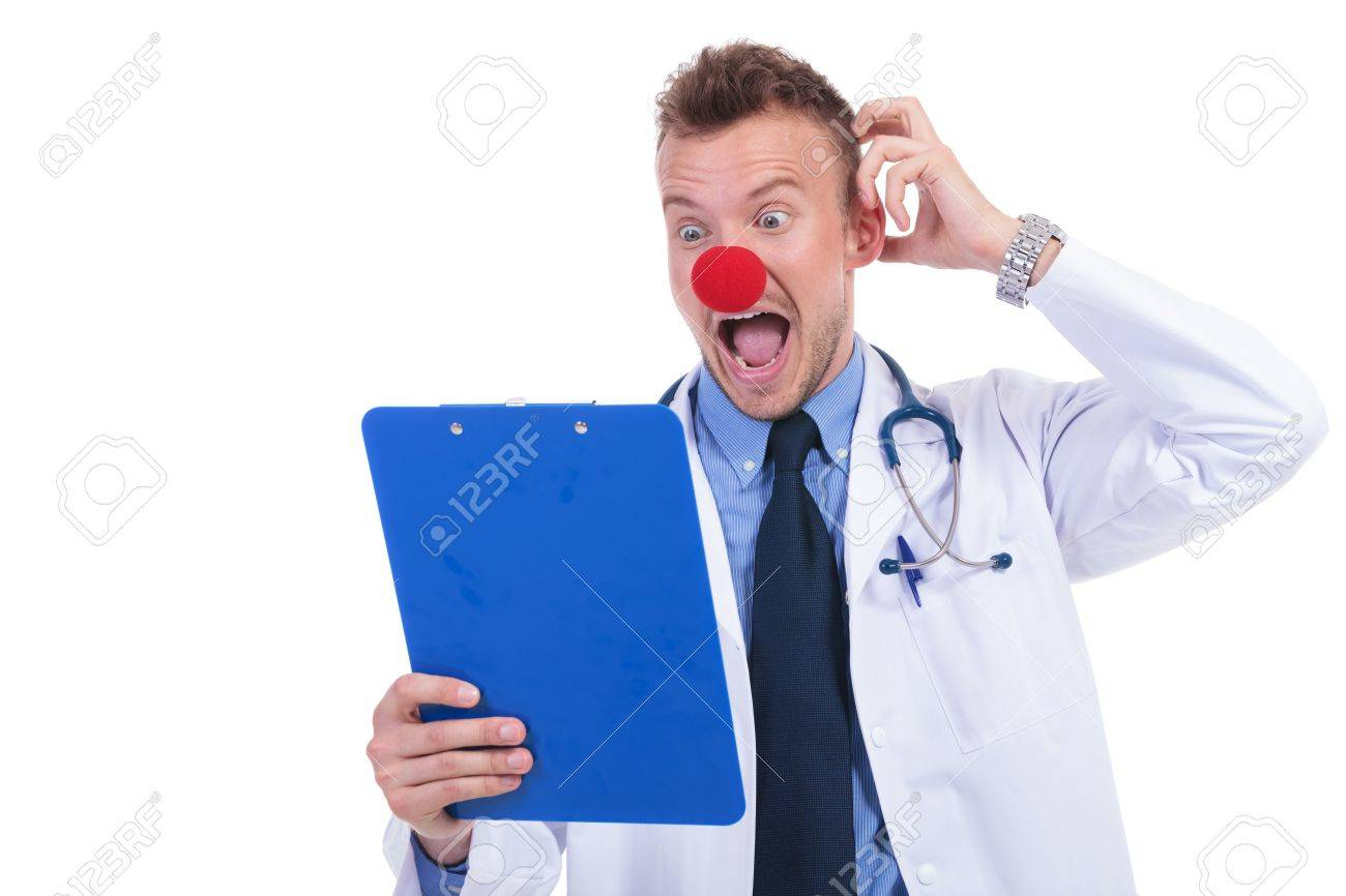clown doctor unable to read the notes on his notepad and looking foolish Stock Photo - 19609258