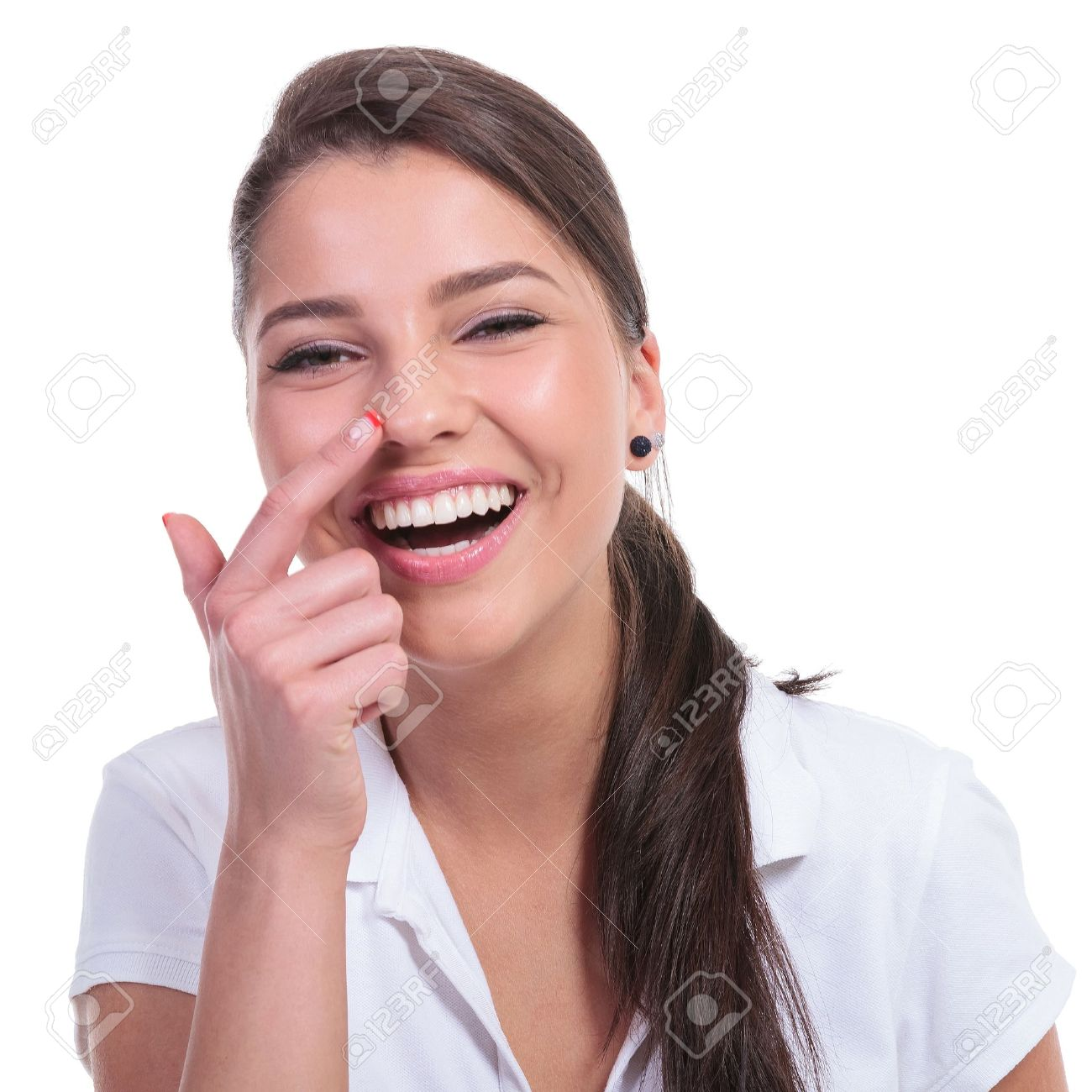 casual young woman touching her nose and laughing at the camera. isolated on white background Stock Photo - 19914336